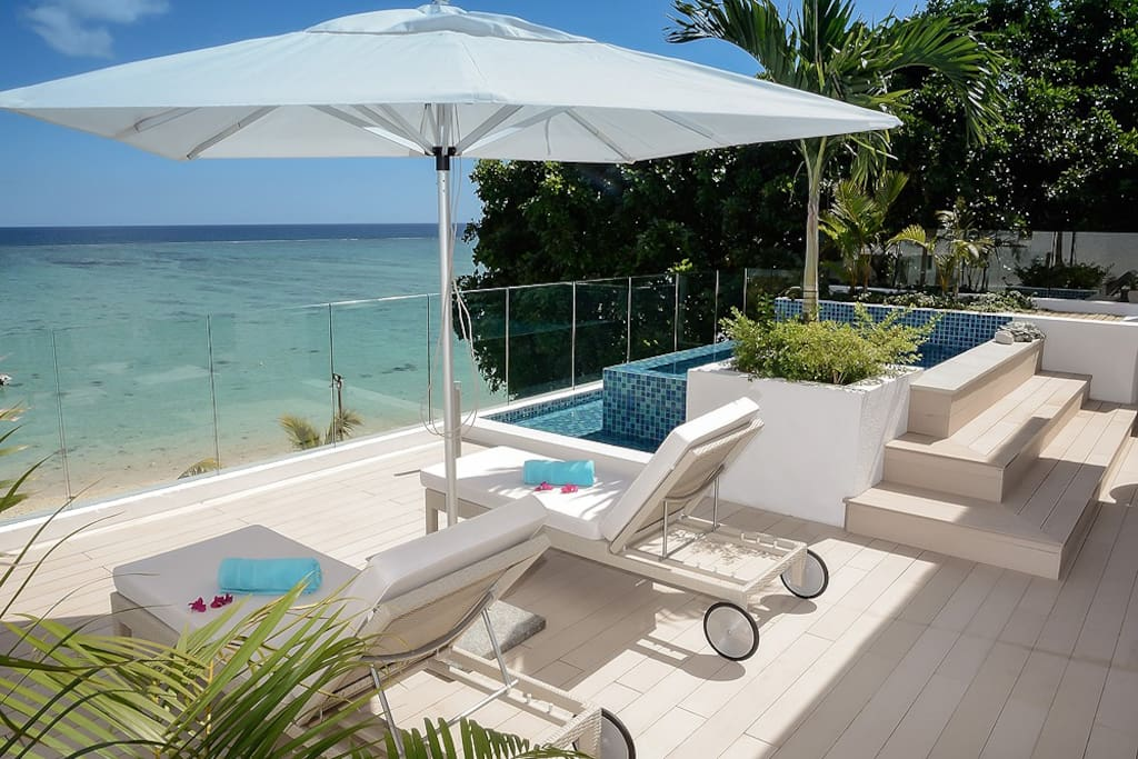 Your private terrace with the view on the sea and your sun loungers