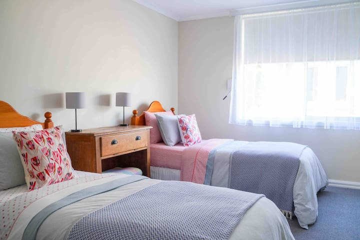 Large third bedroom with 2 single beds.