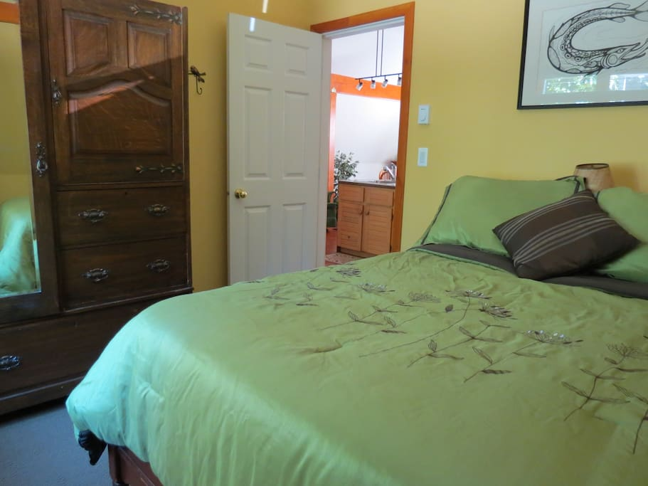 This second bedroom has a double bed with wardrobe.