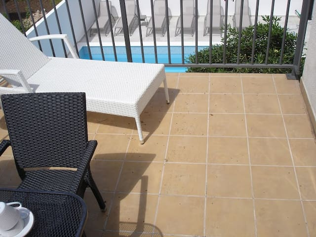 terrace with pool view
