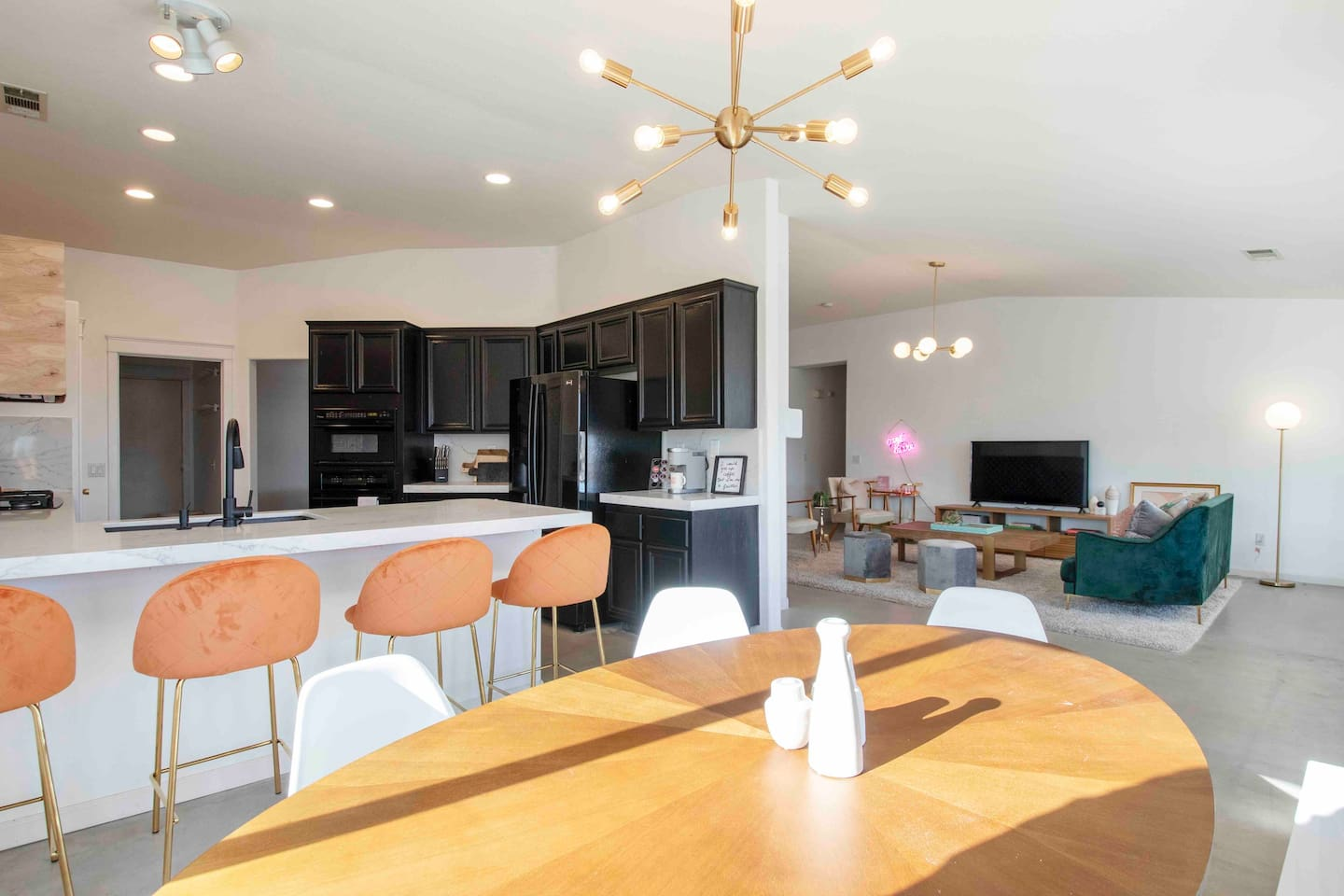 The Dining Room has a breakfast bar that seats 4 plus the dining table provide seats for 8 people. It is open to the living area and has easy access to outdoor dining by the pool. A complete view of the pool right from this dining area.