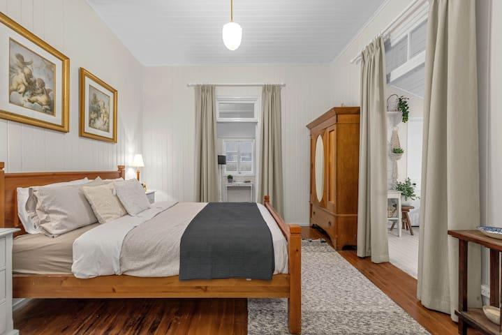 warm bedroom open onto front verandah and side verandah