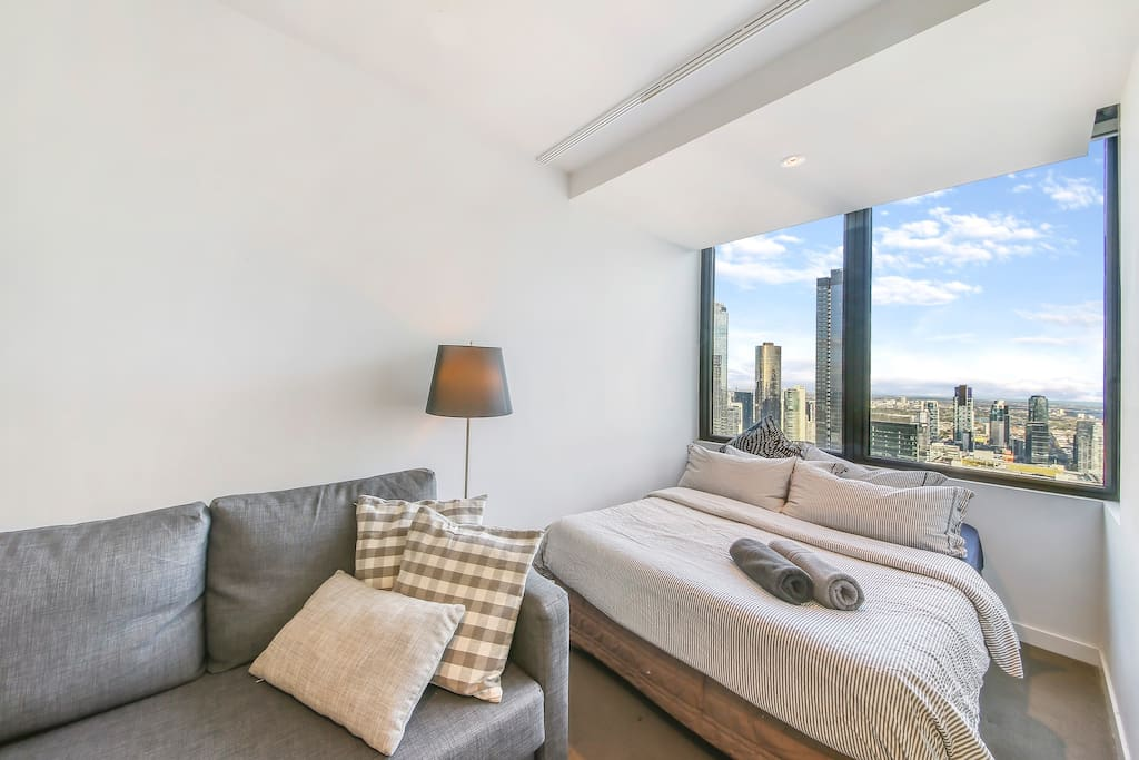 A comfy double bed with plush pillows & a magical view.