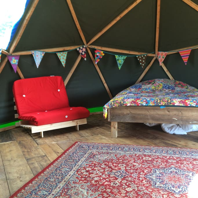 The dome has one double bed and two fold down 3 ft wide futons.