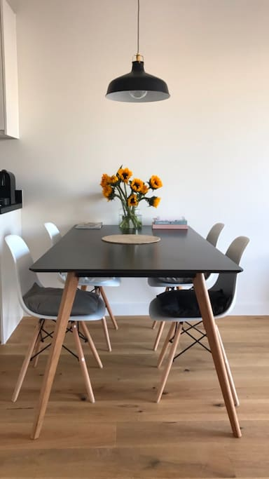 Dining area with 4 chairs, plus two additional if required