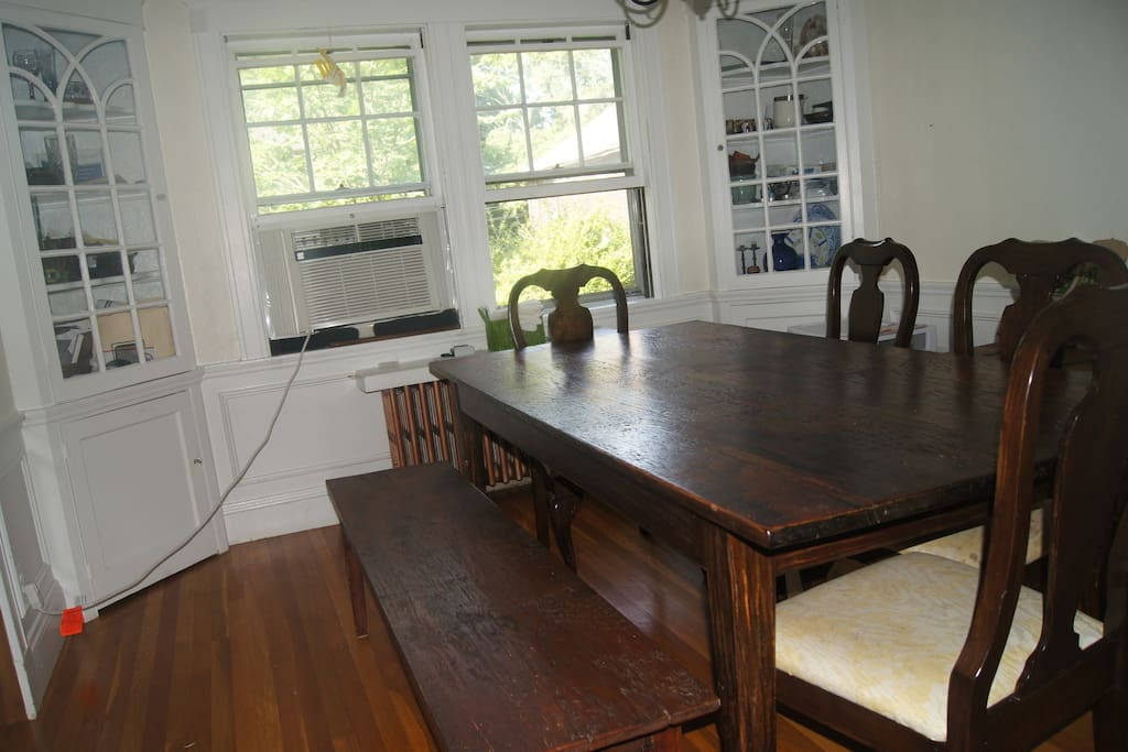 Dining room with long farm-style table that sits six to eight comfortably.