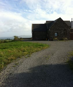 Hello,  My cottage is suitable for people that want to enjoy the peace and quite of the country side but not completely isolated as it is quite close to the picturesque villages of Schull and Ballydehob.     kitchen and living space are open plan with three bedrooms adjacent.