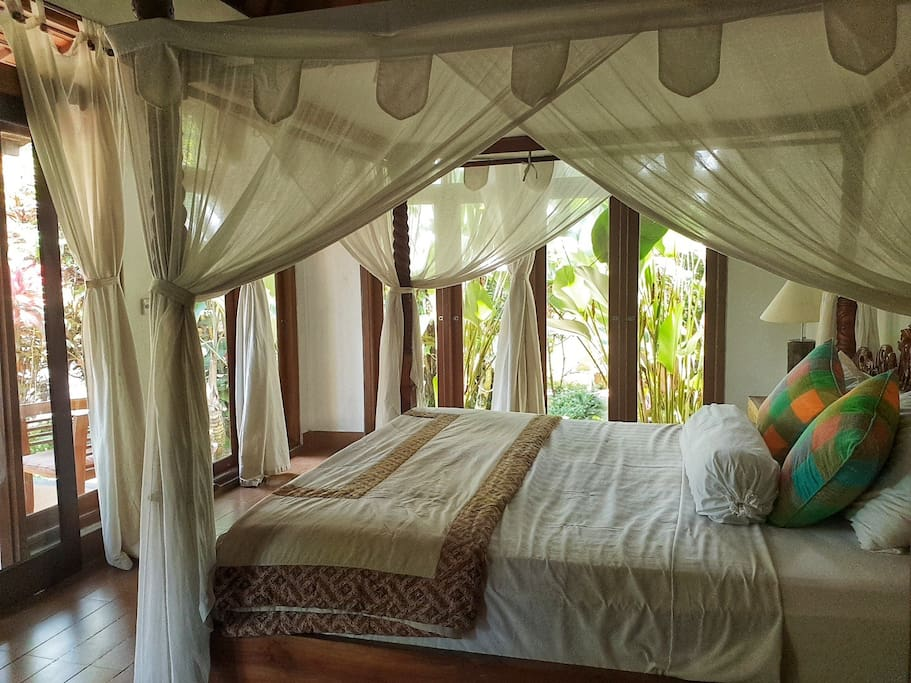 Queen size bed provide with romantic mosquito net