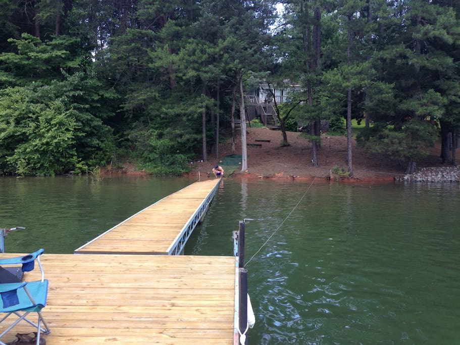 Sitting on the dock, looking down the walk way.  Lake house in the background
