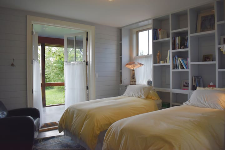 This downstairs bedroom has two twins and french doors that open onto the screened porch.