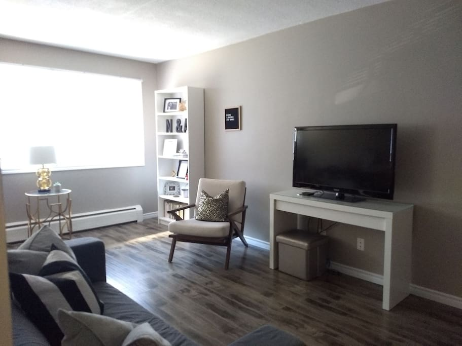 The Livingroom is a bright space with an HD television, a couch and seats.
