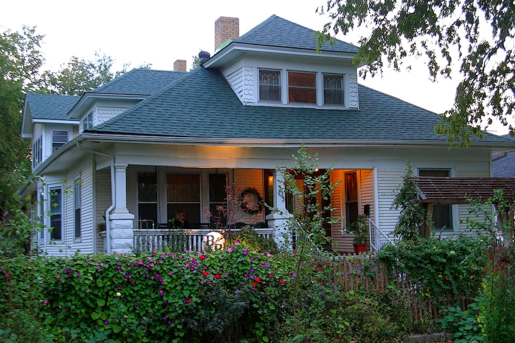 Enjoy the evening on the front porch or tour the surrounding cottage garden.