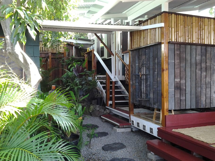 exterior view of outdoor shower and steps leading up to sleeping quarters