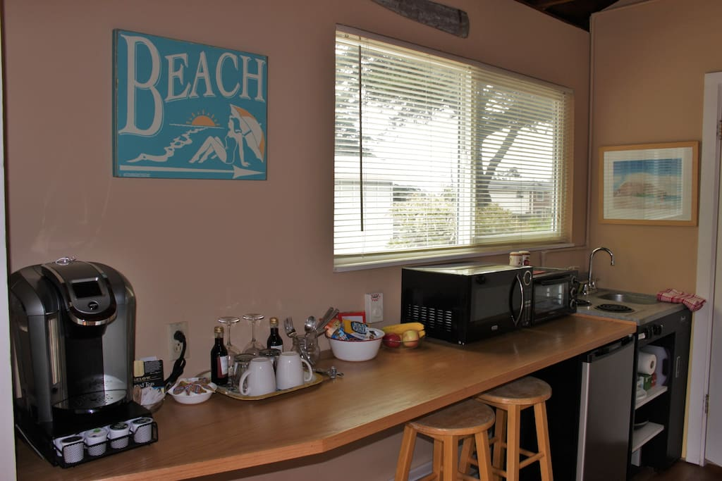 Kitchen amenities include, Keurig coffee maker, microwave, toaster oven, electric stove, sink and mini-fridge.