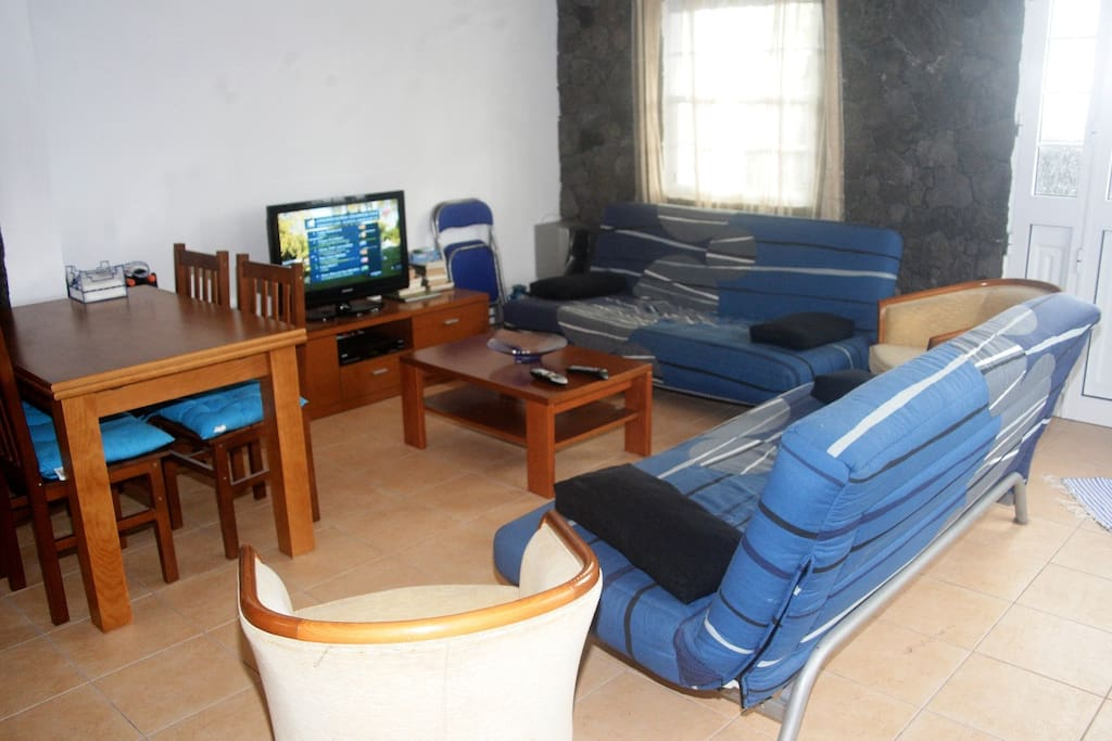 Living room, with two double bed sofas and satélite TV