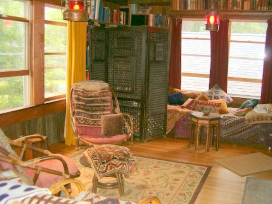 Living room with enthnographic textiles,  antiquarian library, & original pine floors