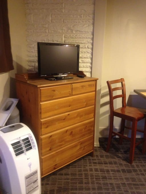 Television with cable and portable air conditioning/fan