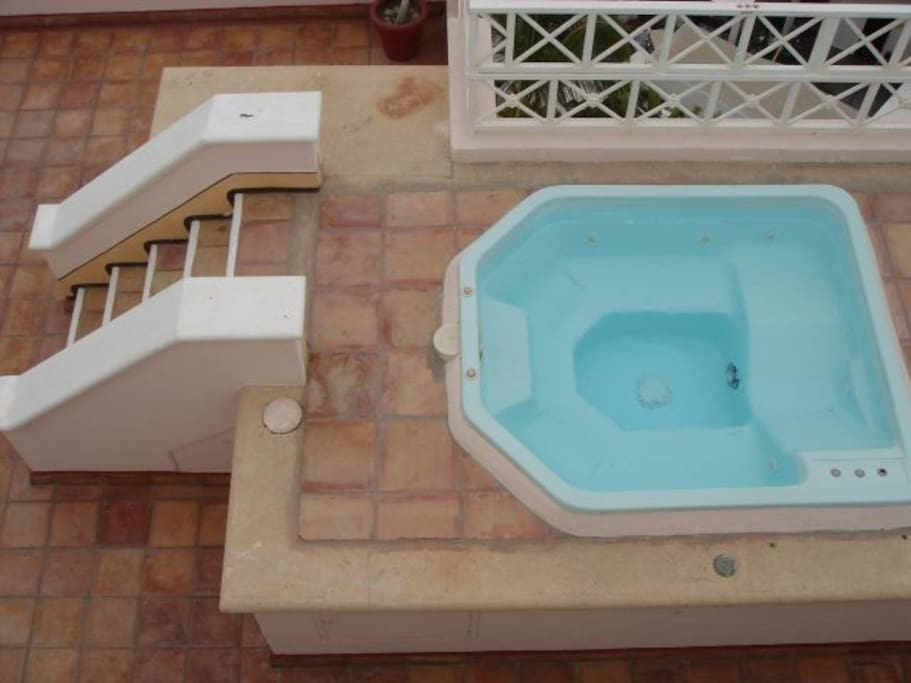 Your private penthouse jacuzzi on main patio  deck off dining room