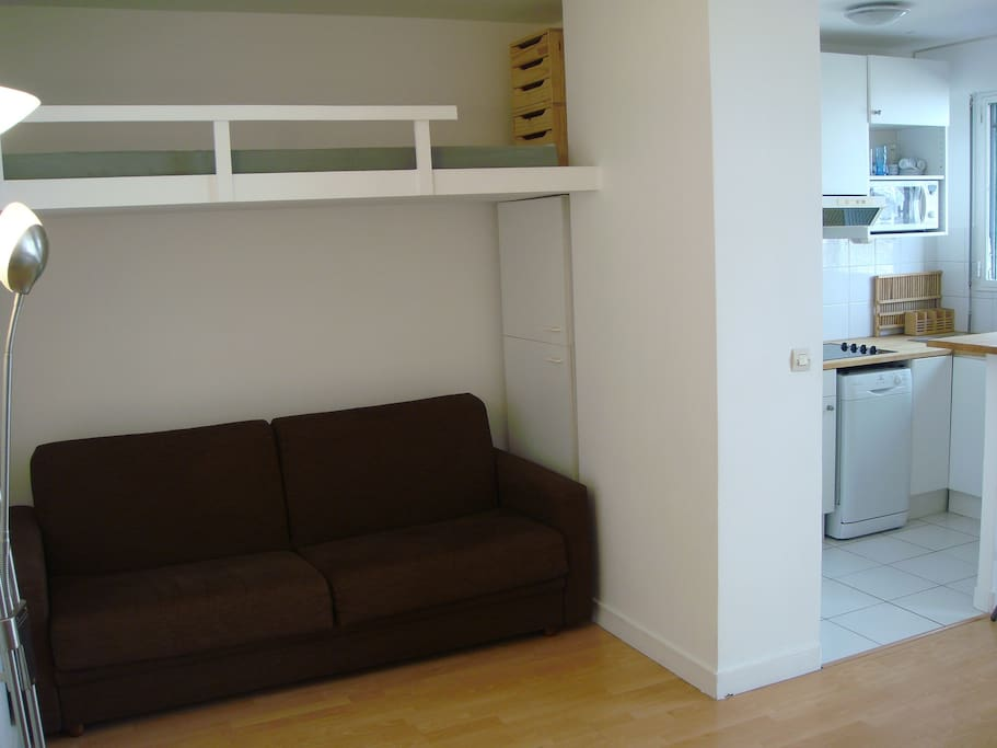 Bedding area isolated by a wall from Kitchen: 1 King size sofa bed & 1 single bed on the top accessible by ladder