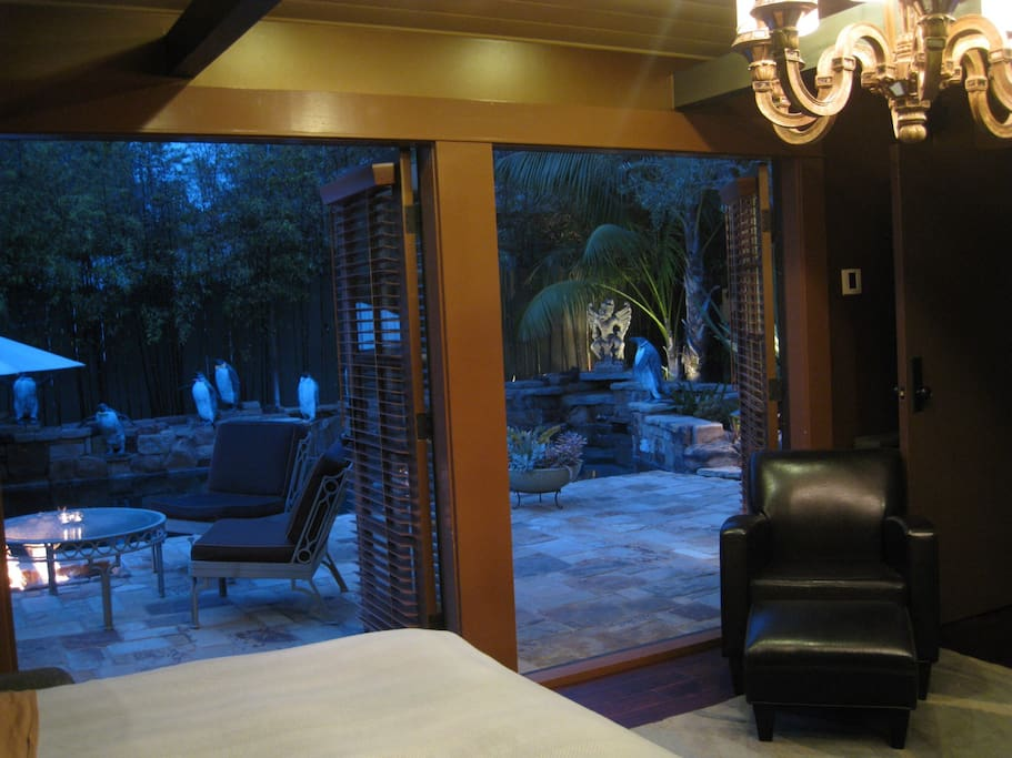 The 2 double French doors practically convert the bedroom to an open-air room.