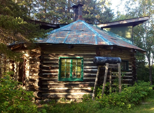 Octagonal log cabin on 200 acre farm.