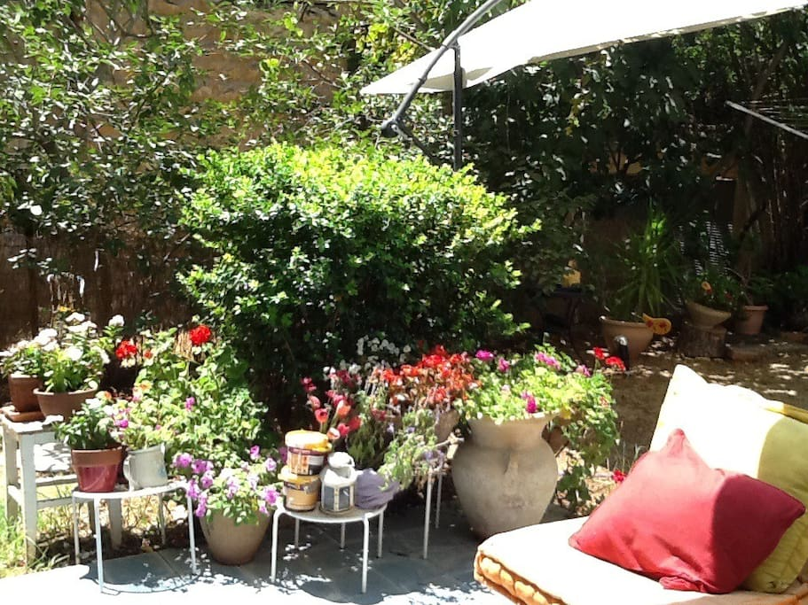 Garden patio with tiled floor with space for entertaining, and Succah.