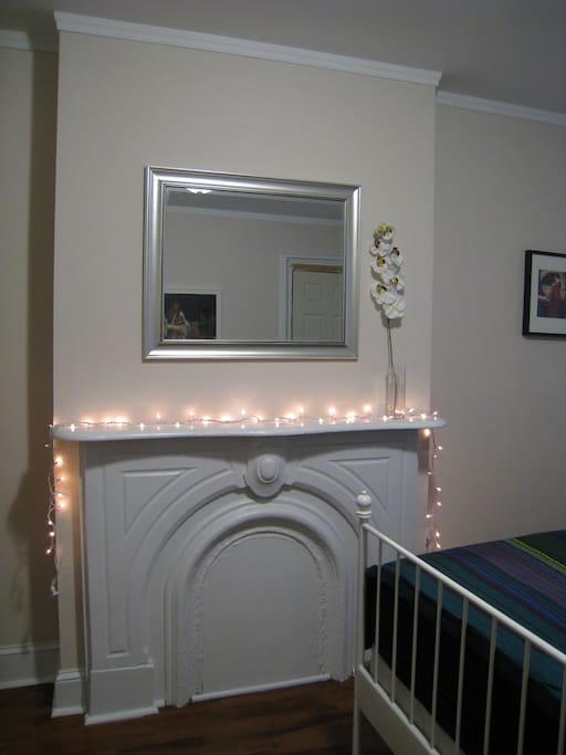 The original (now closed) fireplace and the mantle