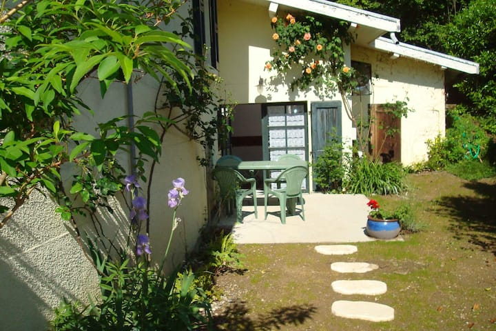 Studio avec jardin dans un espace tranquille.