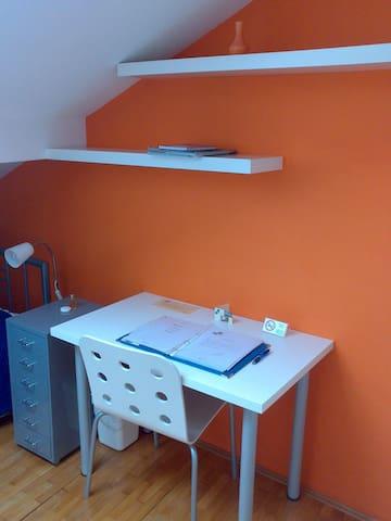 Orange room sleeping and resting area.