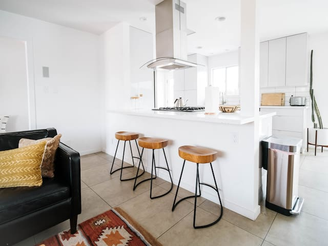 The open floor plan allows you to still be a part of the mix while cooking up a meal in the large and spacious kitchen.