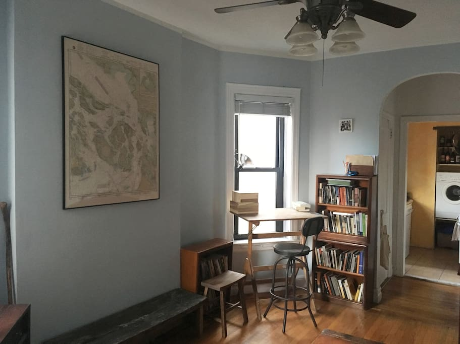 Antique map, tulip poplar bench, bookcases, and oak painting easel