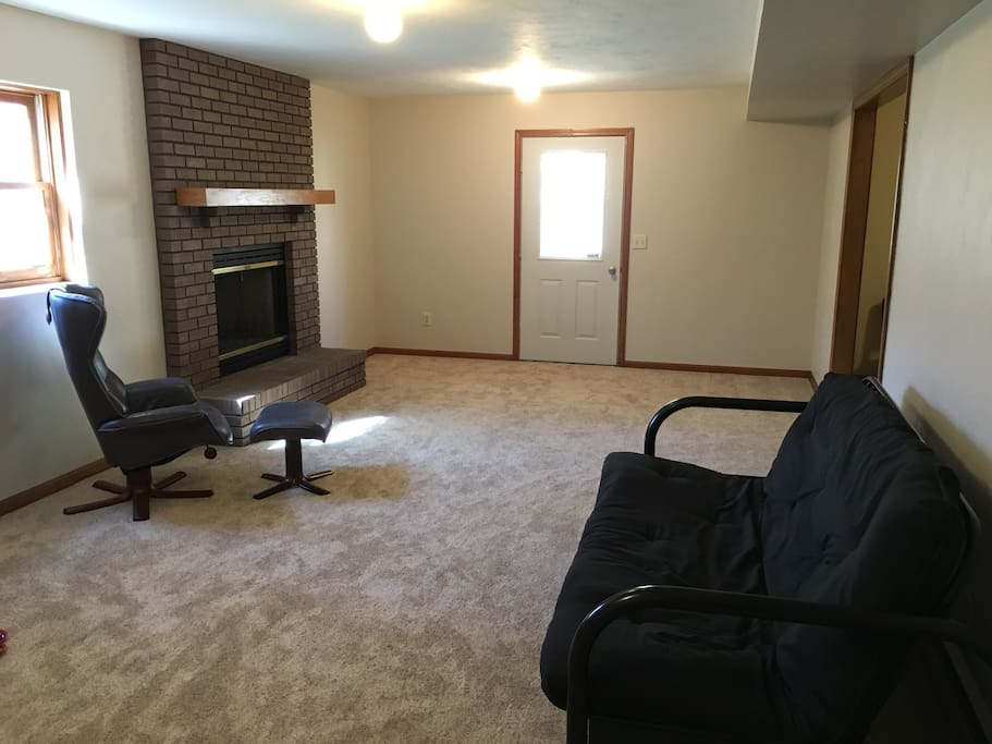 Basement guest living room with private entrance.