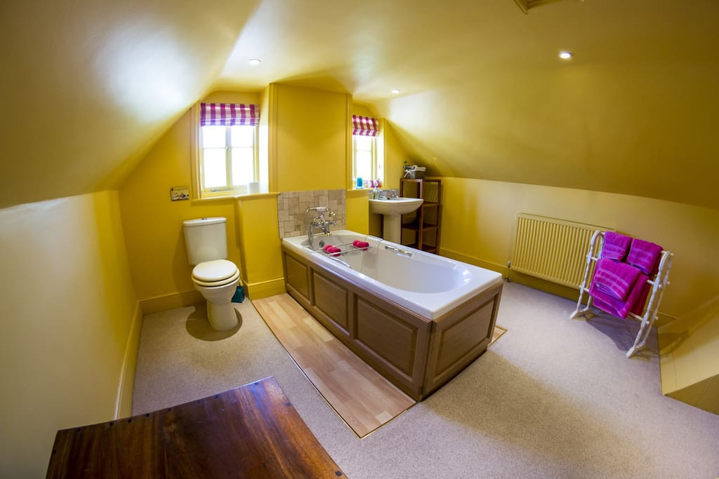 The extremely large en-suite bathroom, bright and airy.