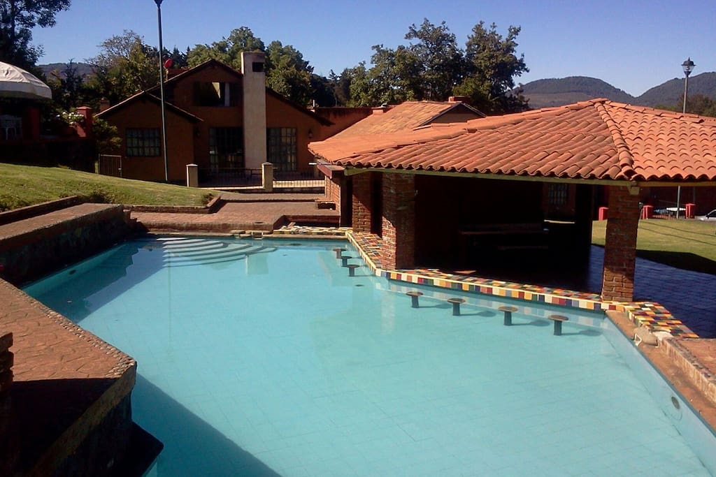 Communal pool, in the background you can see the chalet. The Kiosk has dressing rooms and bathrooms.