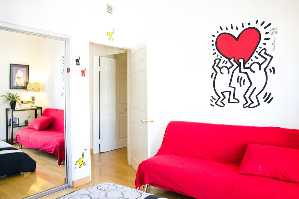 Guest Room - The giant art up on the wall is a Keith Haring wall decal; you'll see from the rest of the apartment that I have an eclectic taste in art.
