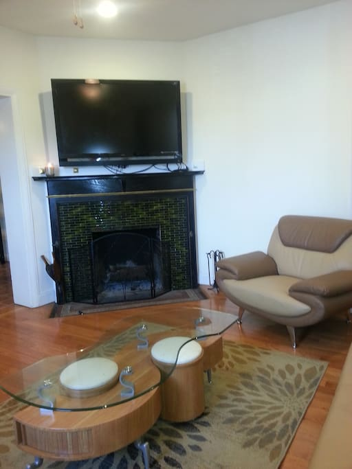 Living room with big screen TV and working fireplace