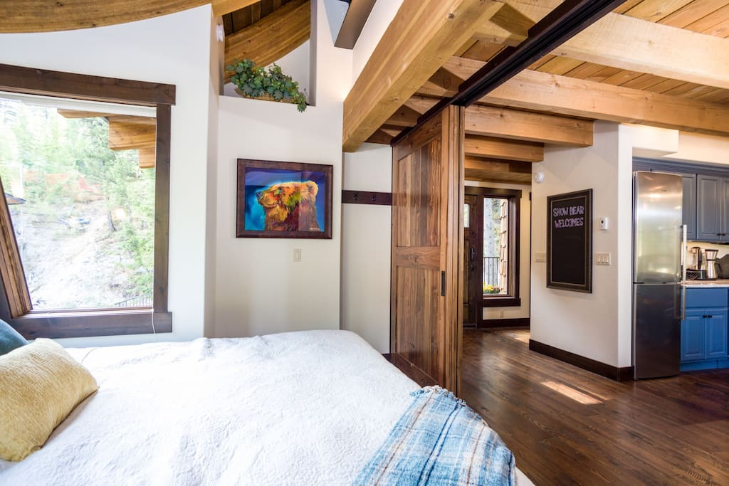 The cantilevered master bedroom features sliding barn doors for privacy whenever desired
