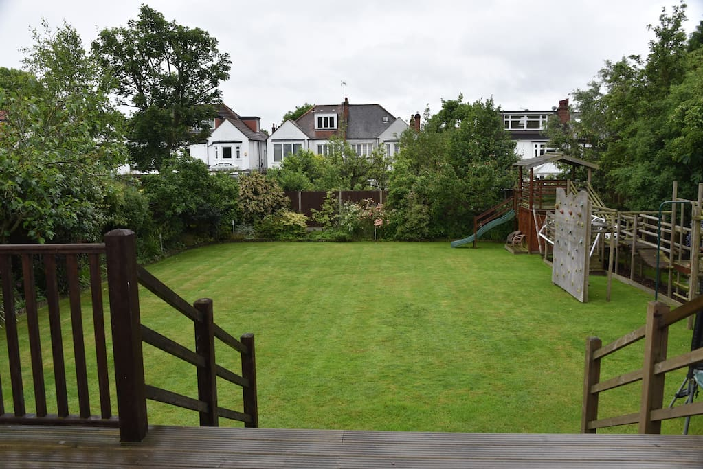 Massive south facing back garden with large deck - great for breakfast on