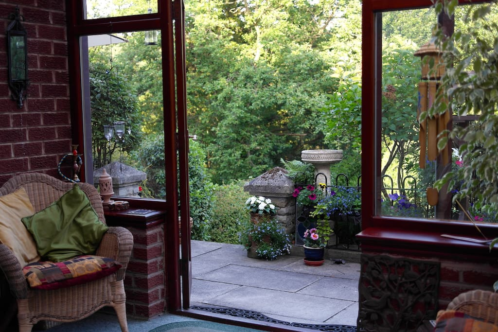 Lovely conservatory opening out onto garden.