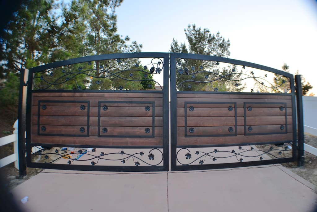 20' Coded mahogany and wrought iron security driveway gate to greet you!