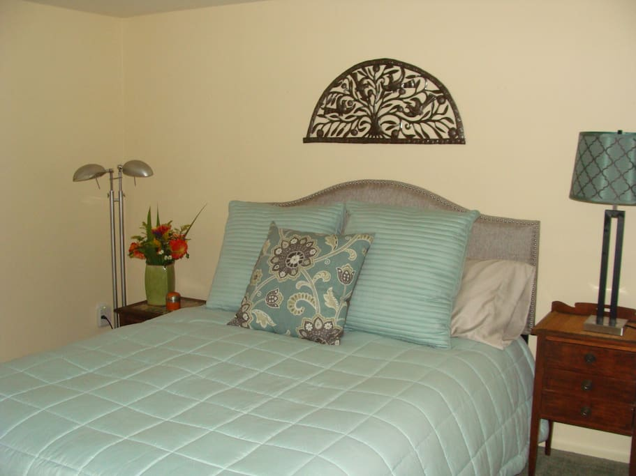 Your queen bedroom with down comforter for a cozy evening.