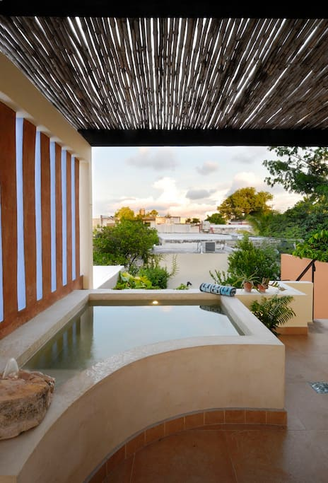 Pool features lighting and a rustic stone water feature...Relax and enjoy!