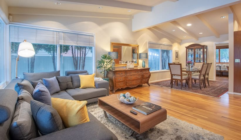 professionally designed interior with a mid-century inspiration awaits you in this  large open floor plan