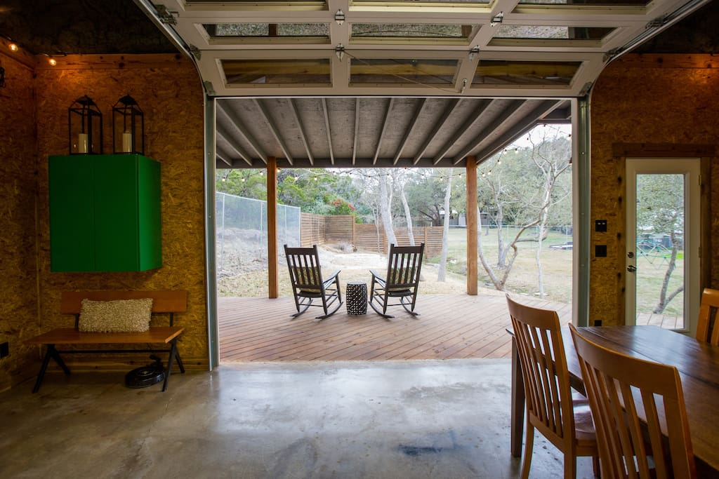 Large glass garage door, let the outdoors in (but turn the AC off first ;)) There are games in the green cabinet.