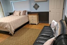Comfortable queen bed and a twin size futon.