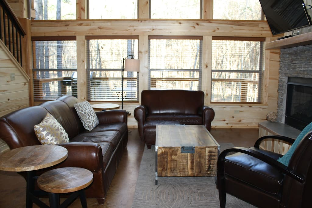 The downstairs living area features a gas-log fireplace and a huge flat screen TV with Direct TV provided.