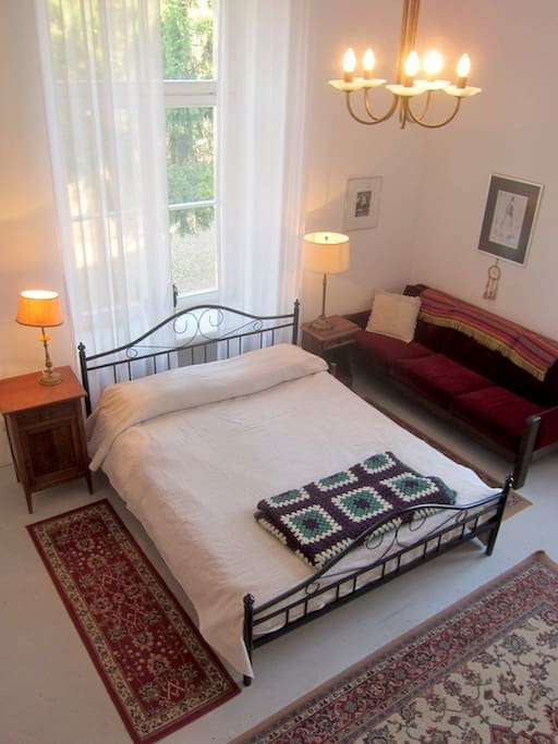 Queen bed in the main bedroom.