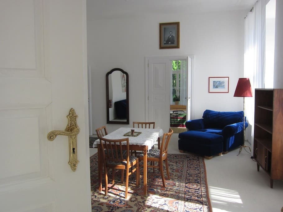 View from the main staircase into the blue suite in The Palace at Naklo. The bedroom in the back has a double bed, while there are two singles in this room.