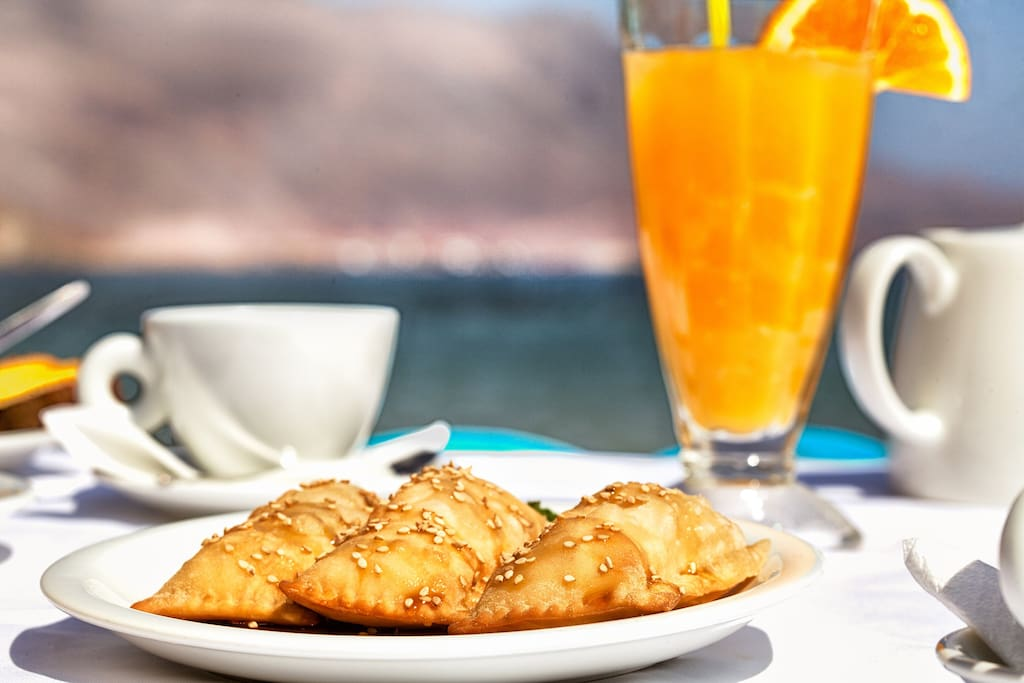 "Free buffet breakfast on the beach front restaurant ""The Cellar"", 70 metres from our lodging"