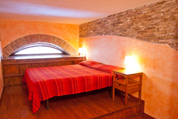 double bed in the bedroom  and there is also a single bed